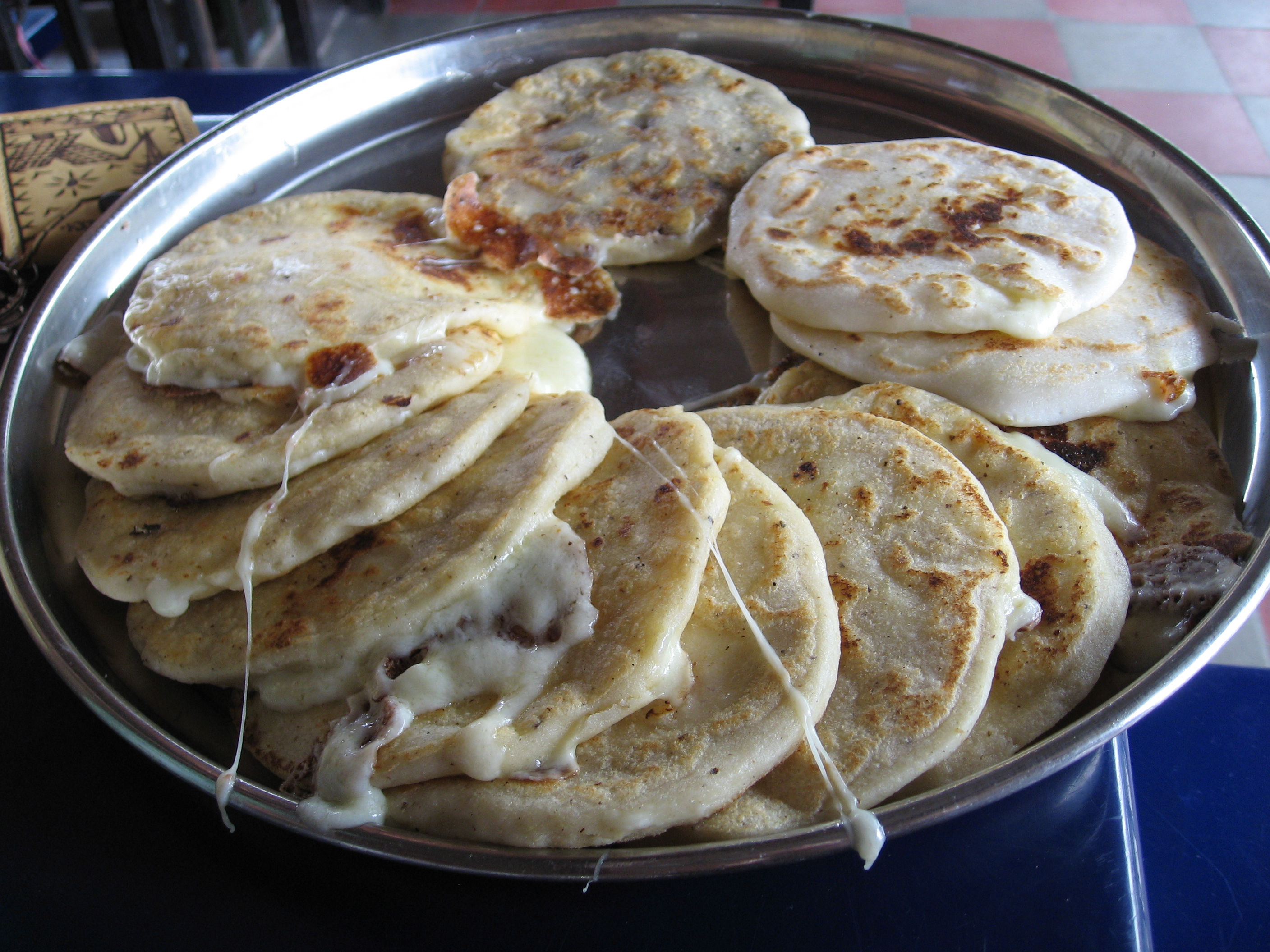 nourish ourselves with pupusas and look towards the looming volcano in ...